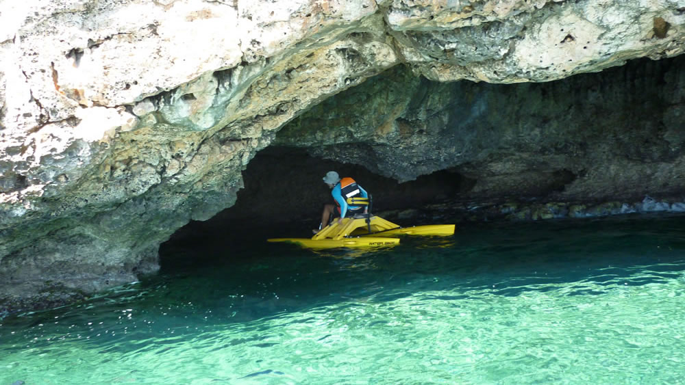 A waterbiker entering a sea cave